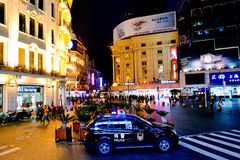 Chinese police car guarding Nanjing Road in Shanghai, China Royalty Free Stock Image