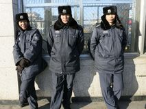Chinese Police Officers. Standing in an urban area looking serious stock image