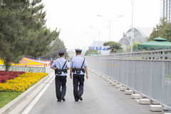 Chinese police patrol the streets Royalty Free Stock Images