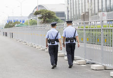 Chinese police patrol the streets Stock Photos