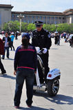 Chinese Policeman on Segway answering the public Royalty Free Stock Images