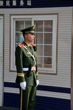 Chinese policeman smartly stands guard in Beijing China Royalty Free Stock Photo