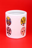 Chinese porcelain. In red background.Pattern on the porcelain is mask of Beijing opera Royalty Free Stock Photo