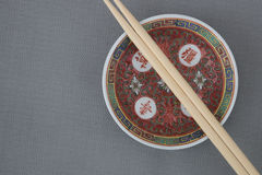 Chinese porcelain. Closeup of Chinese porcelain bowl and chopsticks top view in studio shot Stock Photos