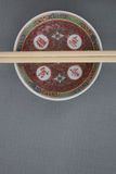 Chinese porcelain. Closeup of Chinese porcelain bowl and chopsticks top view in studio shot Stock Photography