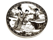 Chinese porcelain saucer sepia Royalty Free Stock Photos