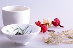 Chinese porcelain. Chinese tea cup and some Dried flowers Royalty Free Stock Image
