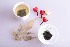 Chinese porcelain. Chinese tea cup and some Dried flowers Royalty Free Stock Images