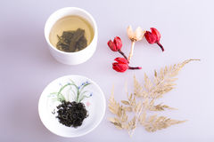 Chinese porcelain. Chinese tea cup and some Dried flowers Royalty Free Stock Photo