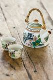 Chinese porcelain teapot and two cups Royalty Free Stock Photo