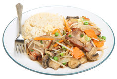 Chinese Pork with Vegetables & Rice. Chinese takeaway of pork with seasonal vegetables and fried rice Stock Photos