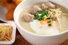 Chinese porridge. Traditional chinese porridge rice gruel in bowl Royalty Free Stock Images