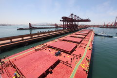 Into the Chinese port of Qingdao ore carriers Royalty Free Stock Images