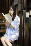 Chinese Portrait of young beautiful woman reads Book In Bookstore Stock Images