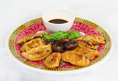 Chinese Pot Stickers. Pot Stickers on a plate with sauce Royalty Free Stock Photo