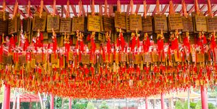 Chinese pray tag translate to english are all happy of my life. A lot of chinese pray tag are in a chinese temple at Suphanburi provinc, Thailand Stock Photography