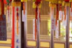 Chinese praying tags. In the buddhist temple tags attached to the lanterns Stock Photos