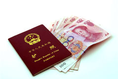 Chinese (PRC) passport and currency. Chinese (PRC) passport front cover and RMB(Yuan) 100 bills view Royalty Free Stock Image