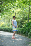 Chinese pregnant woman in park Stock Image