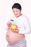 Chinese Pregnant women Hold a bank card Royalty Free Stock Photos