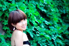 Chinese pretty girl in a park Royalty Free Stock Images