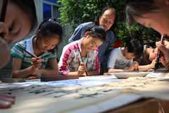 Chinese primary school students in learning callig stock image