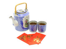 Chinese prosperity tea set and red packets. For tea ceremoney on white background Stock Image