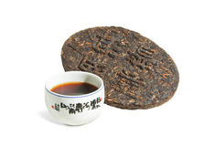Chinese Puer (Pu-erh) tea. Aromatic black pu-erh tea from yunnan province in China. Puerh - fermentation tea into brick Royalty Free Stock Image