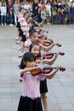 Chinese pupils play the violin Stock Image