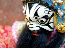 Chinese Puppet. A wooden puppet of a chinese opera singer with painted face Stock Photo