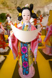 Chinese puppet. Rare luxury puppet,china ancient costume girl with paper in her hands Royalty Free Stock Photo