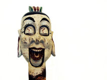 Chinese puppet head. With question marks on the eyelids and an moving mouth isolated against a white background Stock Photos