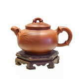 Chinese purple sand teapot isolated. Purple sand teapot isolated on white with clipping path ,the traditional chinese tea utensils stock photos