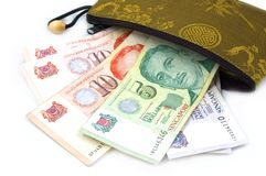 Chinese Purse with Singapore Dollars. Singapore Dollars with Chinese Purse Royalty Free Stock Image