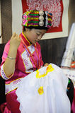 Chinese qiang girl embroidering a picture Stock Photos