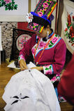 Chinese qiang woman embroidering a picture Stock Photo
