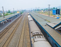 Chinese railway. Station with a dual-layer train stoped.Photo is taken on 29 April 2011 Royalty Free Stock Photo