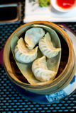 Chinese ravioli on a wooden cylinder plate Royalty Free Stock Photography