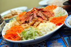 Chinese raw fish salad Royalty Free Stock Photography