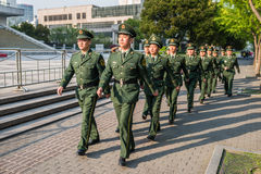 Chinese red army soldiers marching in the street of shanghai chi Royalty Free Stock Photos