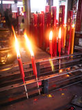 Chinese red candle. In steel grating at chinese shrine for making merit in chinese new year festival Stock Photography