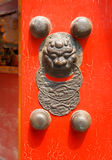 Chinese red door with a dragon head Royalty Free Stock Photos