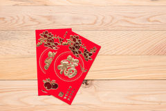Chinese Red Envelope use in Chinese new year festival on wooden. Top view Chinese Red Envelope use in Chinese new year festival on wooden background. Translation Royalty Free Stock Photography