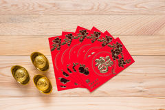 Chinese Red Envelope use in Chinese new year festival on wooden. Top view Chinese Red Envelope use in Chinese new year festival on wooden background. Translation Stock Photos