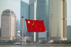 Chinese red flag in the bund of Shanghai Stock Photos