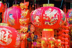 Chinese red lantern and fake firecrackers:words mean `Good Luck, Healthy and Get Rich` for the chinese new year stock photo