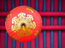 Chinese red lantern hanging on the roof, bottom view. royalty free stock photos