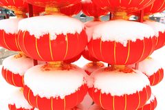 Chinese red lantern on snow Royalty Free Stock Photos