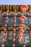 Chinese Red Lanterns. Festive Chinese lanterns hanging from building in San Francisco`s Chinatown. Vertical Stock Photo