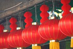 Chinese red lanterns hanging on the rope in a line on sky background. Celebration chinese New Year 2018 at Waro Market Chiang royalty free stock photography